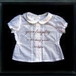 Your Fragility... 2010, mother's (artist's) hair from gestation period embroidered on child's garment, velvet, 14 x 15""
